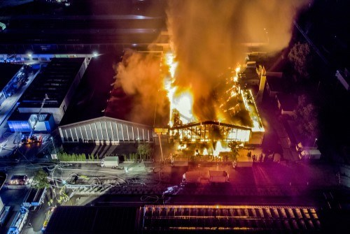 Image of a big fire in a warehouse from above